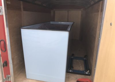 inside of red utility trailer
